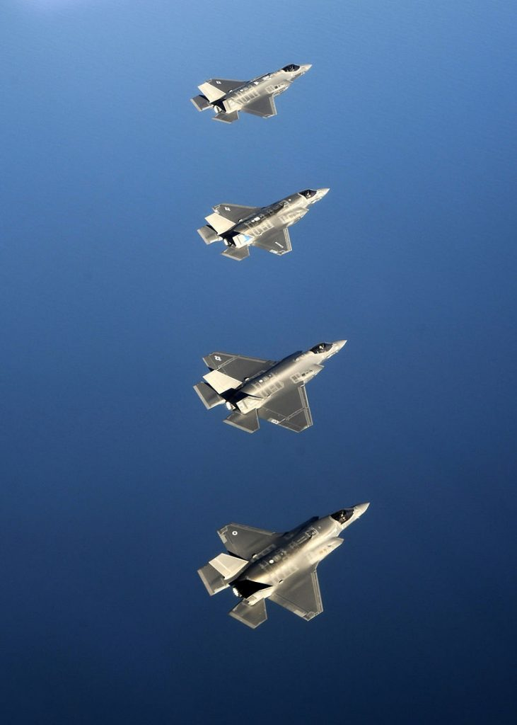 One of the UK's F-35 aircraft (bottom) flying alongside American versions of each F-35 variant over Eglin Air Force Base in 2014. (U.S. Air Force Photo)