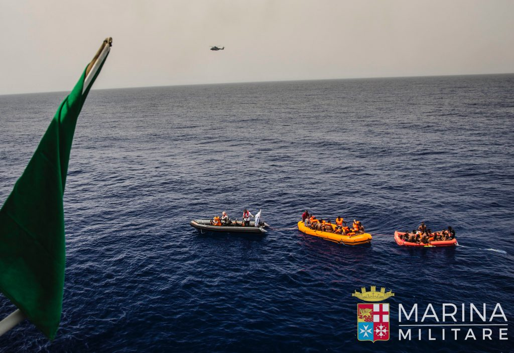 In this photo taken in the Mediterranean Sea, off the Libyan coast, Friday, May 27, 2016, rescuers tow migrants to the Italian Navy ship Vega, after the boat they were aboard sunk. The Italian navy says it has saved 135 migrants from a sinking boat and recovered 45 bodies in the Mediterranean. (Raffaele Martino/Marina Militare via AP Photo)