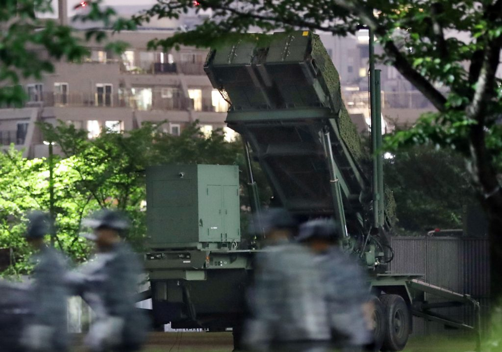 In this Monday, May 30, 2016 photo, Japan Self-Defense Force members walk near PAC-3 missile interceptors deployed to prepare for a possible North korean missile, at the Defense Ministry in Tokyo. A North Korean missile launch likely failed on Tuesday, according to South Korea's military, the latest in a string of high-profile failures that tempers somewhat recent worries that Pyongyang was pushing quickly toward its goal of a nuclear-tipped missile that can reach America's mainland. (Muneki Yajima/Kyodo News via AP) JAPAN OUT, MANDATORY CREDIT
