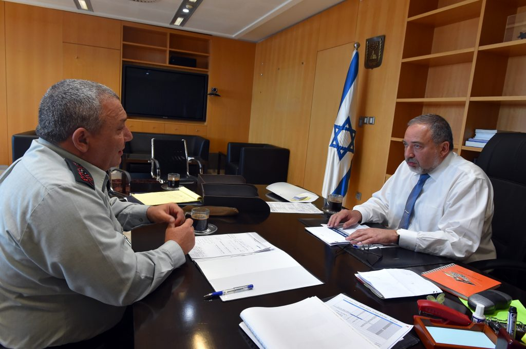 Israel's new Defense Minister Avigdor Lieberman (R) meets with IDF Chief of Staff Gadi Eizenkott at the Defense Ministry in Tel Aviv, on Tuesday. (Ariel Hermoni/Ministry of Defense)