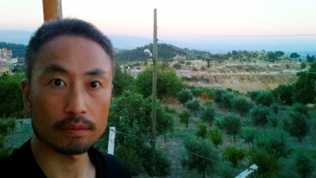 "Japanese journalist Jumpei Yasuda, who is seen in this photo sent by e-mail to a Kyodo News photographer on June 23, 2015 before Yasuda's departure to Syria, with the message reading, ""I will smuggle myself into Syria from now"", is seen in this undated photo released by Kyodo on December 24, 2015. Mandatory credit Kyodo/via REUTERS/File Photo ATTENTION EDITORS - THIS IMAGE WAS PROVIDED BY A THIRD PARTY. EDITORIAL USE ONLY. MANDATORY CREDIT. JAPAN OUT. NO COMMERCIAL OR EDITORIAL SALES IN JAPAN."