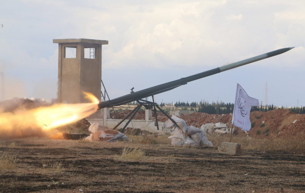 Rebel fighters from the First Regiment, part of the Free Syrian Army, fire a Grad rocket from Aleppo's Al-Haidariya neighbourhood, towards forces loyal to Syria's President Bashar al-Assad stationed in Talet al-Sheikh Youssef, Syria May 29, 2016. REUTERS/Abdalrhman Ismail