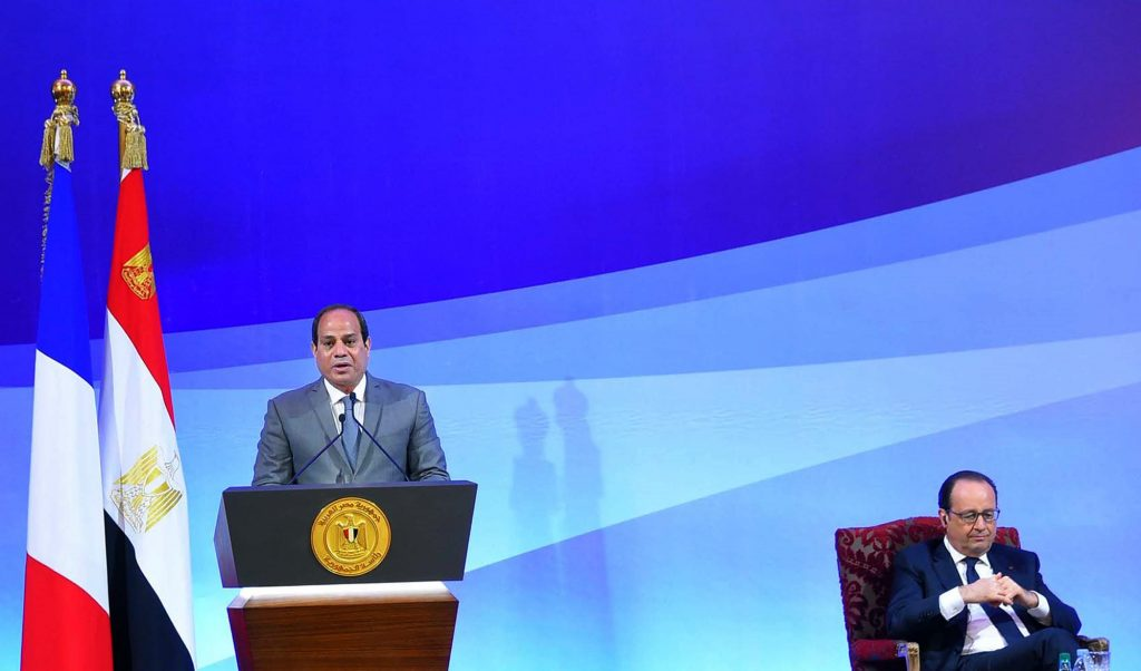 In this photo provided by Egypt's state news agency MENA, Egyptian President Abdel-Fattah el-Sissi, left, and French President Francois Hollande attend an economic conference in Cairo, Egypt, Monday, April 18, 2016. In Egypt as part of a three-nation Middle East tour, the French leader was accompanied by a large business delegation. Hollande and el-Sissi are expected to sign accords in the fields of energy, infrastructure and culture, according to an Egyptian presidential statement. (MENA via AP)