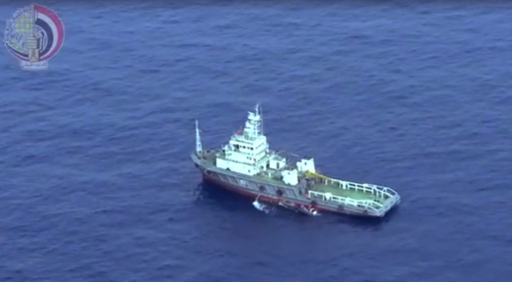 This still image taken from video posted Saturday, May 21, 2016, on the official Facebook page of the Egyptian Armed Forces spokesman shows an Egyptian ship collecting wreckage of EgyptAir flight 804. Smoke was detected in multiple places on EgyptAir flight 804 moments before it plummeted into the Mediterranean, but the cause of the crash that killed all 66 on board remains unclear, the French air accident investigation agency said on Saturday. (Egyptian Armed Forces via AP)