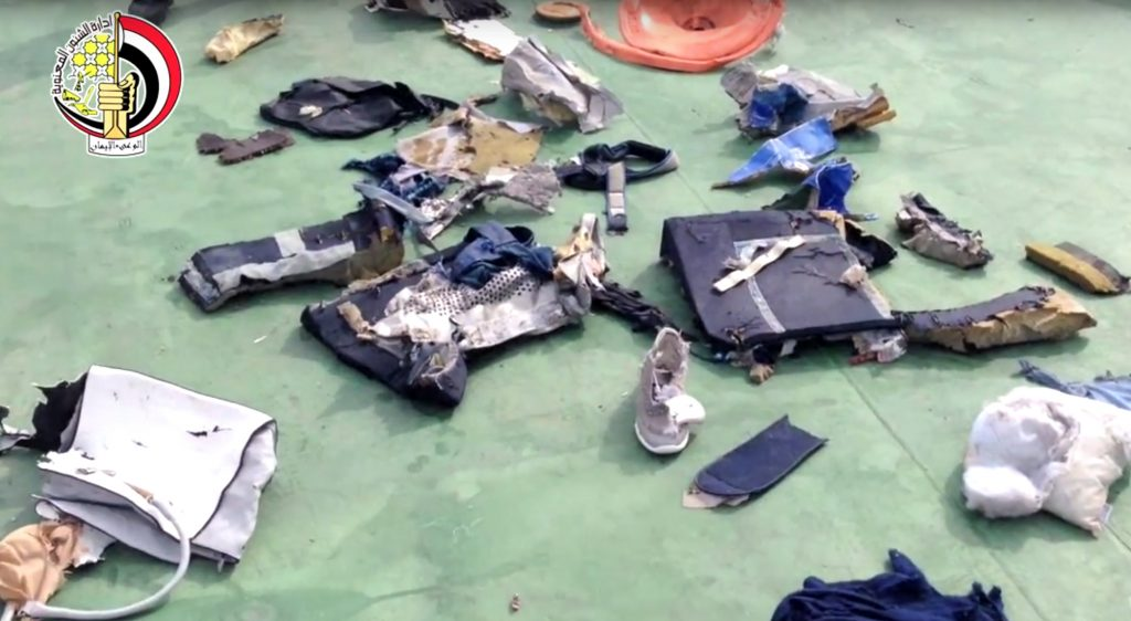 FILE - This file still image taken from video posted Saturday, May 21, 2016, on the official Facebook page of the Egyptian Armed Forces spokesman shows some personal belongings and other wreckage from EgyptAir flight 804 in Egypt. Human remains retrieved from the crash site of EgyptAir Flight 804 suggest there was an explosion on board that may have brought down the aircraft in the east Mediterranean, a senior Egyptian forensics official said on Tuesday, May 24, 2016. (Egyptian Armed Forces via AP, File)