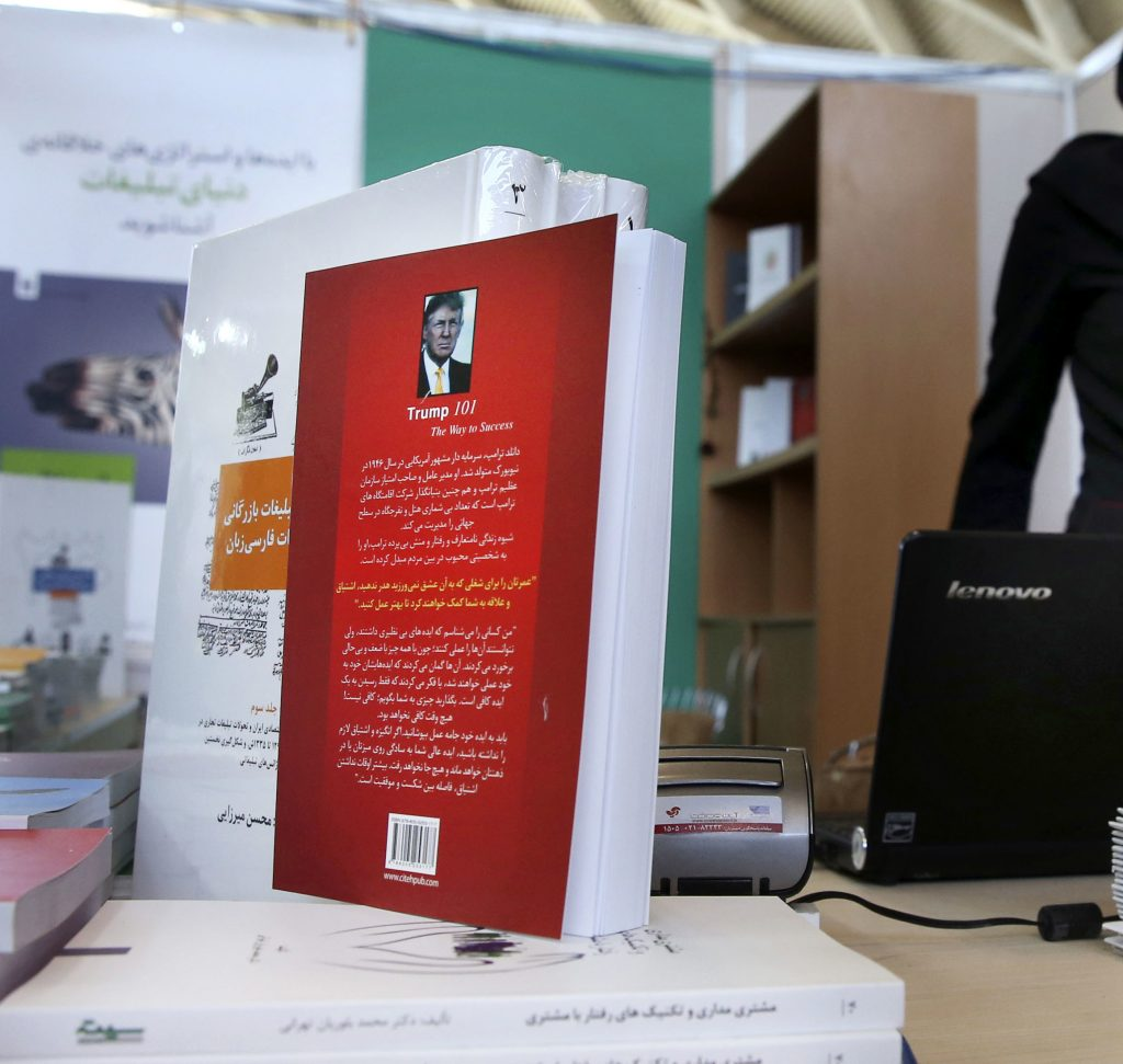 "Presidential candidate Donald Trump's book ""Trump 101: The Way To Success"" in Persian translation on display during Tehran's International Book Fair in Iran. (AP Photo/Vahid Salemi)"