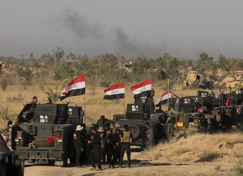 Smoke billows on the horizon as Iraqi military forces prepare for an offensive into Fallujah to retake the city from Islamic State militants in Iraq, Monday, May 30, 2016. A wave of bombings claimed by the Islamic State group targeted commercial areas in and around Baghdad on Monday, killing more than 20 people in attacks that came as Iraqi troops poised to recapture Fallujah. (AP Photo/Khalid Mohammed)