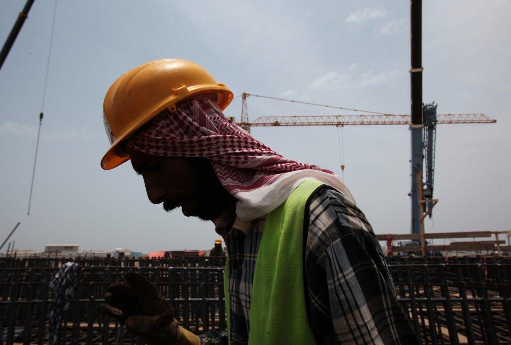 A man works at a construction site in Jiddah, Saudi Arabia. (AP Photo/Hasan Jamali, File)