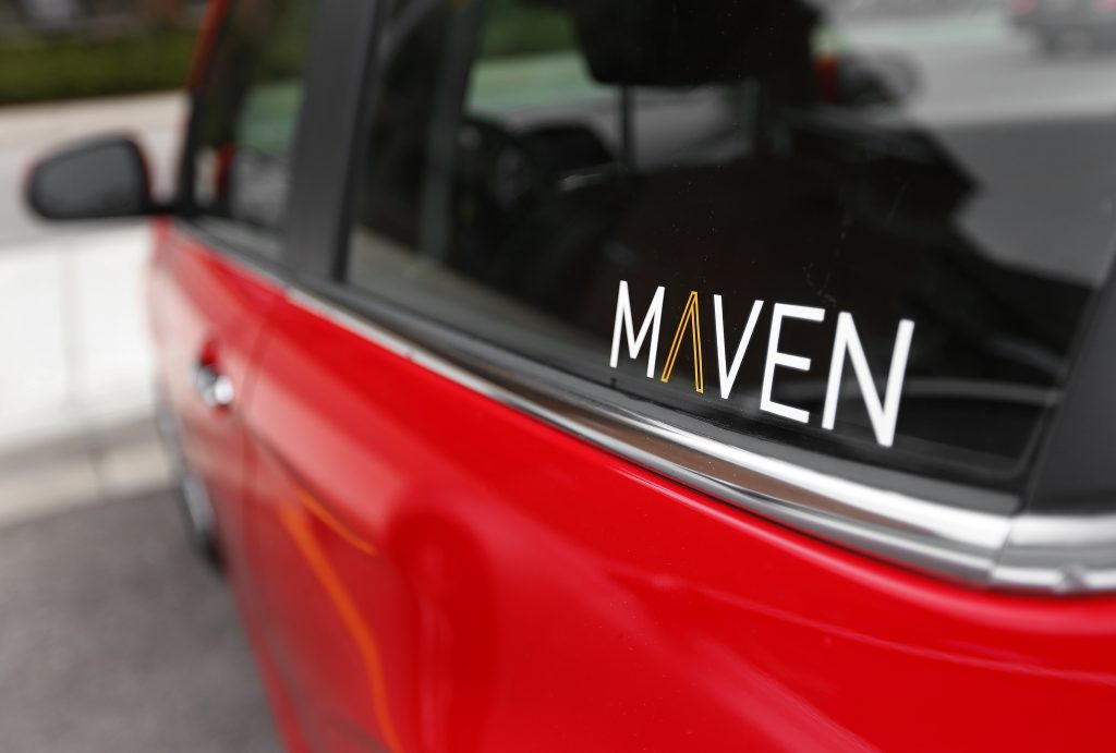 The Maven logo on a vehicle in the General Motors car-sharing service, in Ann Arbor, Mich. (AP Photo/Paul Sancya)
