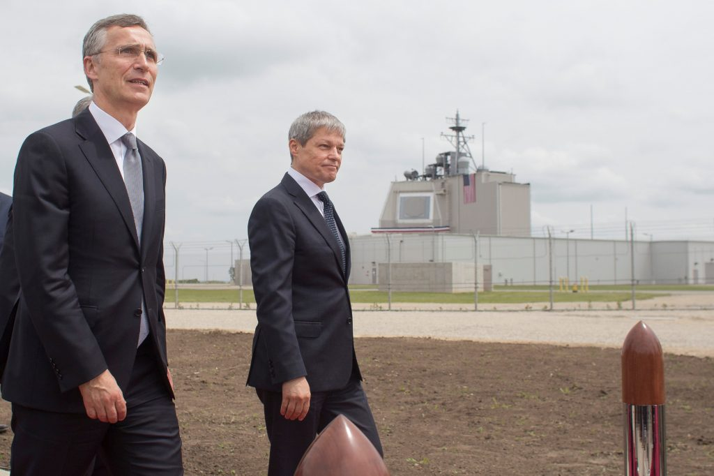 NATO Secretary General Jens Stoltenberg (L) and Romanian Prime Minister Dacian Ciolos arrive for an official inauguration ceremony at Deveselu air base, Romania, May 12, 2016.  Inquam Photos/Octav Ganea/via REUTERS ATTENTION EDITORS - THIS IMAGE WAS PROVIDED BY A THIRD PARTY. EDITORIAL USE ONLY. ROMANIA OUT. NO COMMERCIAL OR EDITORIAL SALES IN ROMANIA.