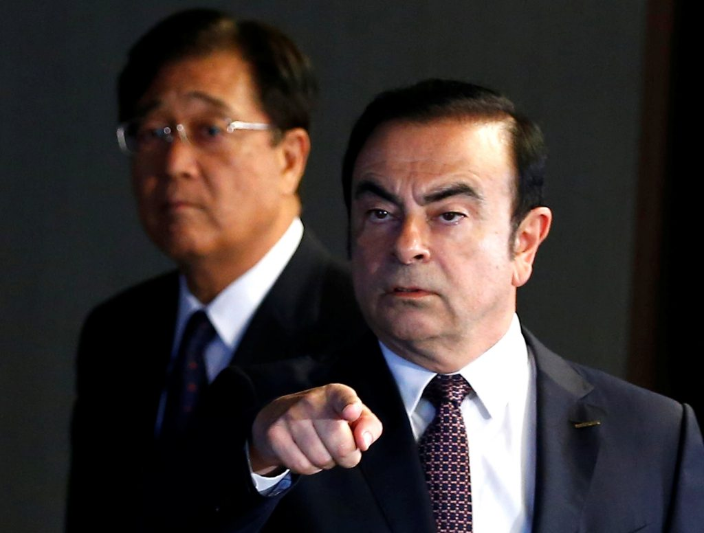 Carlos Ghosn (R), Chairman and CEO of the Renault-Nissan Alliance, and Mitsubishi Motors Corp.'s Chairman and CEO Osamu Masuko arrive for their joint news conference in Yokohama, Japan, May 12, 2016. REUTERS/Thomas Peter