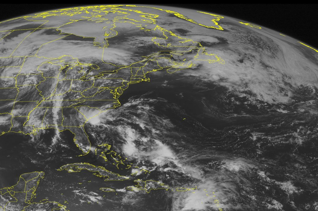This NOAA satellite image taken Saturday, May 28, 2016 at 9:45 AM EDT shows Tropical Depression Two continuing to move northwest towards the North and South Carolina coastline as it is expected to slightly strengthen into a weak tropical storm before making landfall. Elsewhere, a weak frontal boundary is draped across northern portions of New England, with thunderstorms beginning to develop across New York and Pennsylvania. A broad amount of cloud cover is also observed over the Midwestern United States with a north-south oriented frontal boundary. (Weather Underground va AP)