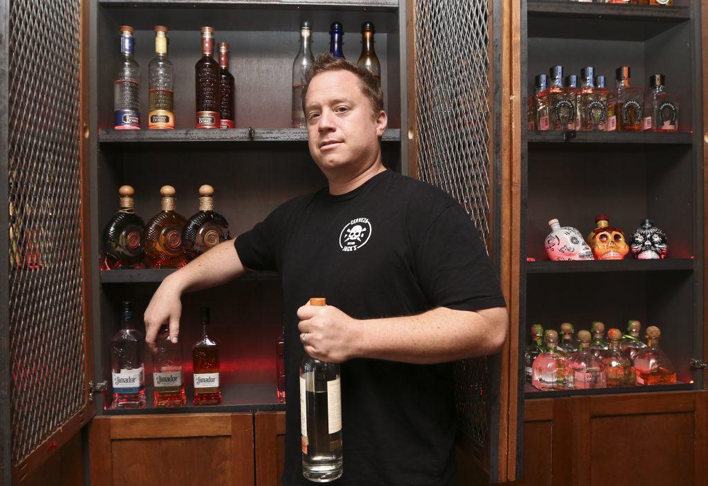 Frank Miller, part owner of The Blind Burro in San Diego. (AP Photo/Lenny Ignelzi)