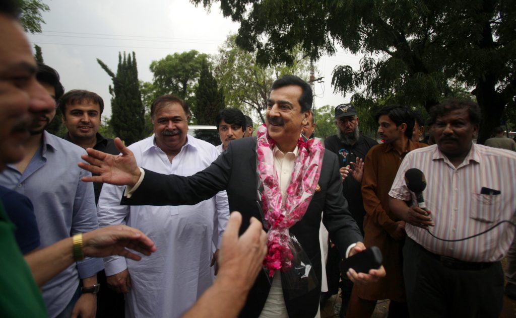 Pakistan's former Prime Minister Yusuf Raza Gilani, center, being greeted by supporters at outside his residence in Islamabad, Pakistan, Tuesday, after his son  was rescued. (AP Photo/Anjum Naveed)