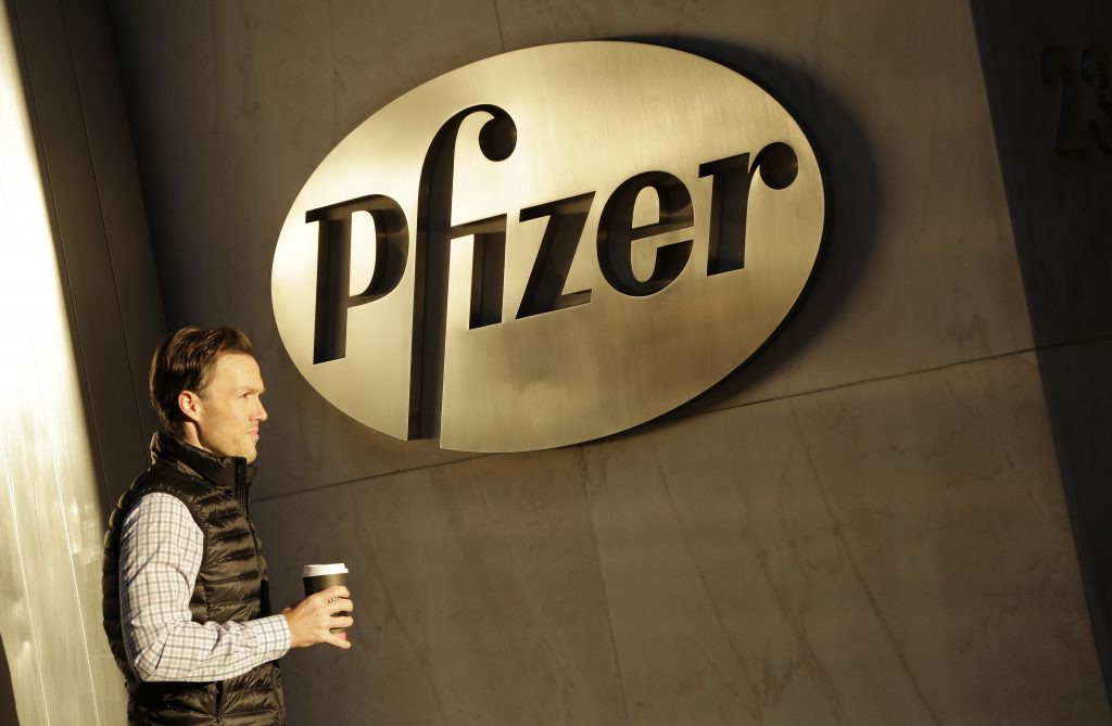 FILE - In this Monday, Nov. 23, 2015, file photo, a man enters Pfizer's world headquarters, in New York. Pfizer is buying Anacor Pharmaceuticals Inc. in a deal announced Monday, May 16, 2016. (AP Photo/Mark Lennihan, File)