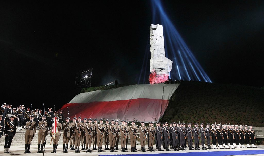 FILE - The May 8, 2015 file photo shows Polish Navy troops standing at the foot of the monument to Polish defenders of the Westerplatte peninsula, where some of World War II's first shots were fired, during ceremonies marking the 70th anniversary of the end of the war in Gdansk, Poland. A museum under creation for the past eight years, the Museum of the Second World War, was due to open in Gdansk in 2017 but its fate is threatened by the country's new nationalistic government. The government objects to its international approach and prefers a project that would focus exclusively on Westerplatte and the Polish military defense against Germany in 1939. (AP Photo/Czarek Sokolowski, file)