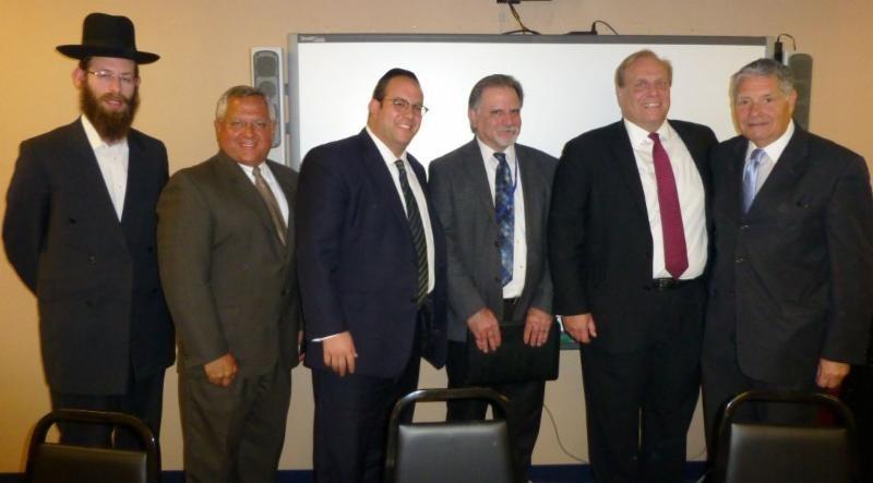 Rabbi Shimshon Balsam; Gus Kavakas; Rabbi Avi Schnall; State Monitor Mike Azzara; Commissioner David Hespe; Senator Robert Singer (R-Monmouth).