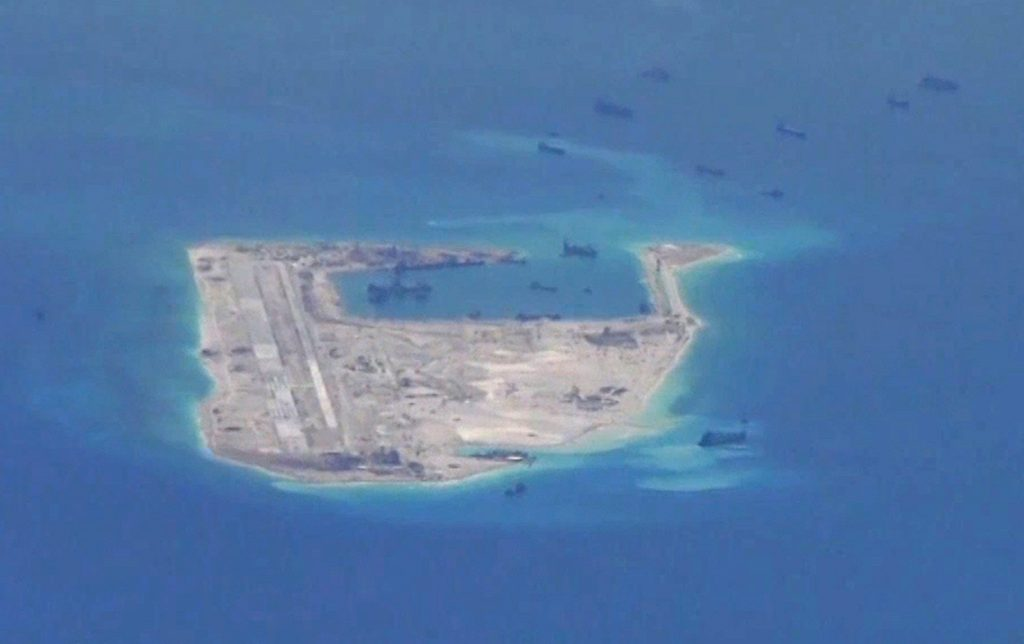Chinese dredging vessels are purportedly seen in the waters around Fiery Cross Reef in the disputed Spratly Islands in the South China Sea in this still image from video taken by a P-8A Poseidon surveillance aircraft provided by the United States Navy May 21, 2015. U.S. Navy/Handout via Reuters/File Photo ATTENTION EDITORS - THIS PICTURE WAS PROVIDED BY A THIRD PARTY. EDITORIAL USE ONLY.     TPX IMAGES OF THE DAY