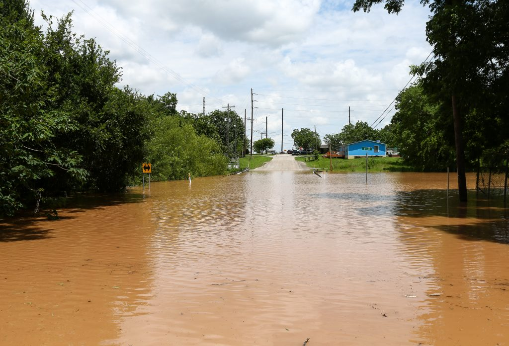 Sixth Street is impassible due to rising flood waters from the Brazos River Sunday, May 29, 2016, in Rosenberg, Texas. (Jon Shapley/Houston Chronicle via AP)
