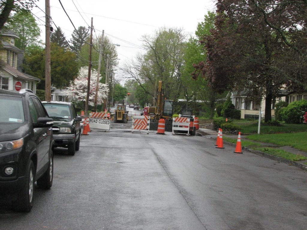 Washington Avenue in Kingston, NY, has been closed for more than five years because of a sinkhole formed by a broken sewer/storm tunnel deep under the street. (Richie W/Flickr)