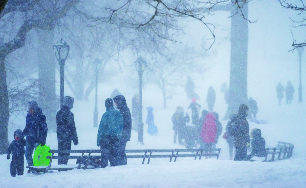 People visit Central Park on Jan. 23, 2016, as the biggest blizzard in New York City history envelops the East Coast. (AP Photo/Craig Ruttle, File)