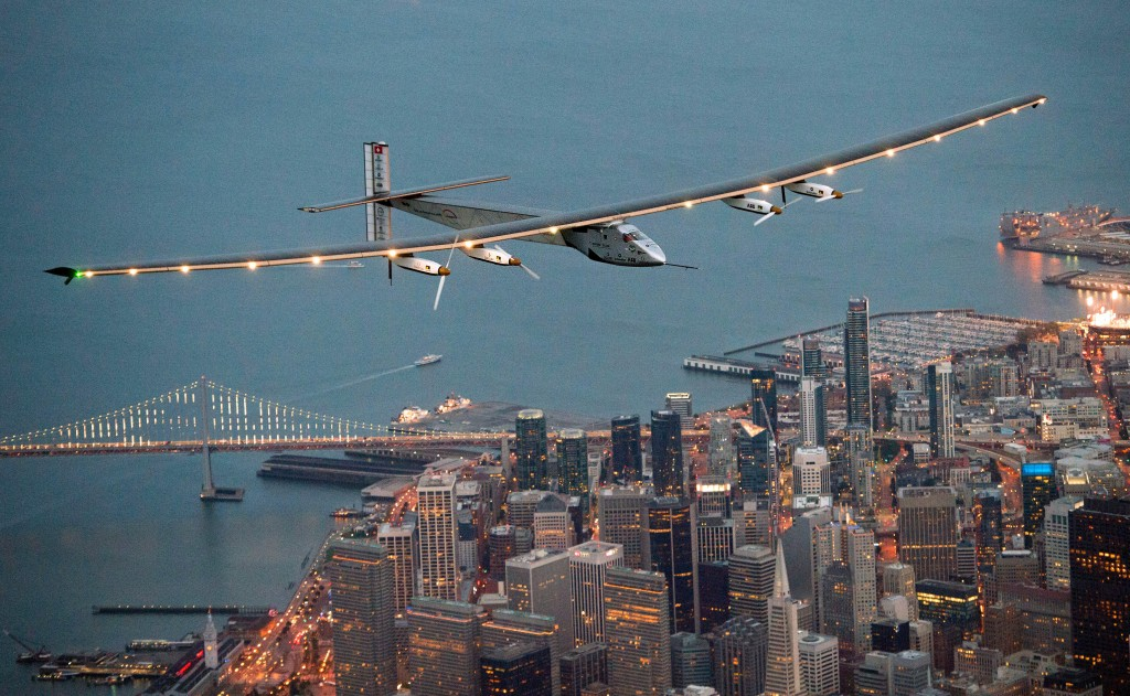 FILE - In this April 23, 2016 file photo, Solar Impulse 2 flies over San Francisco at the end of its journey from Hawaii, part of its attempt to circumnavigate the globe. The next leg of the solar-powered around-the-world flight is scheduled to start from Mountain View, Calif., Monday, May 2, 2016, at 5 a.m. PDT, bound for Phoenix.(AP Photo/Noah Berger, File)