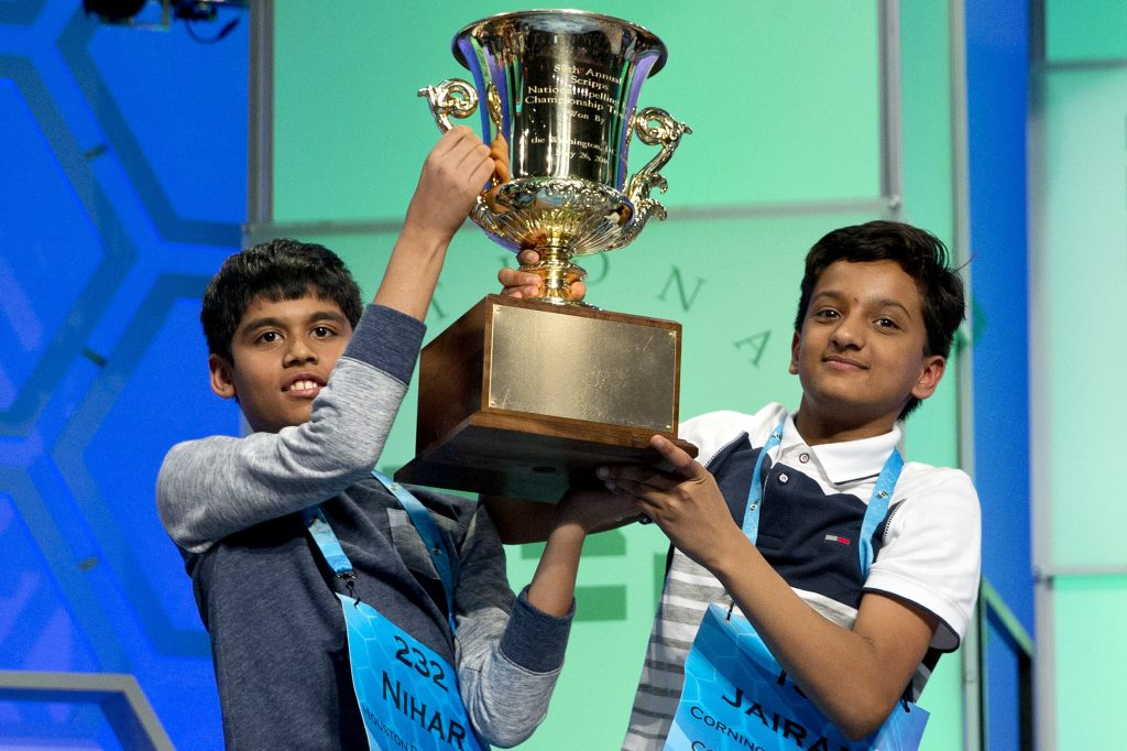 Nihar Janga, 11, of Austin, Texas, and Jairam Hathwar, 13, of Painted Post, N.Y., hold up the trophy after being named co-champions at the 2016 National Spelling Bee, in National Harbor, Md., on Thursday. (AP Photo/Jacquelyn Martin)