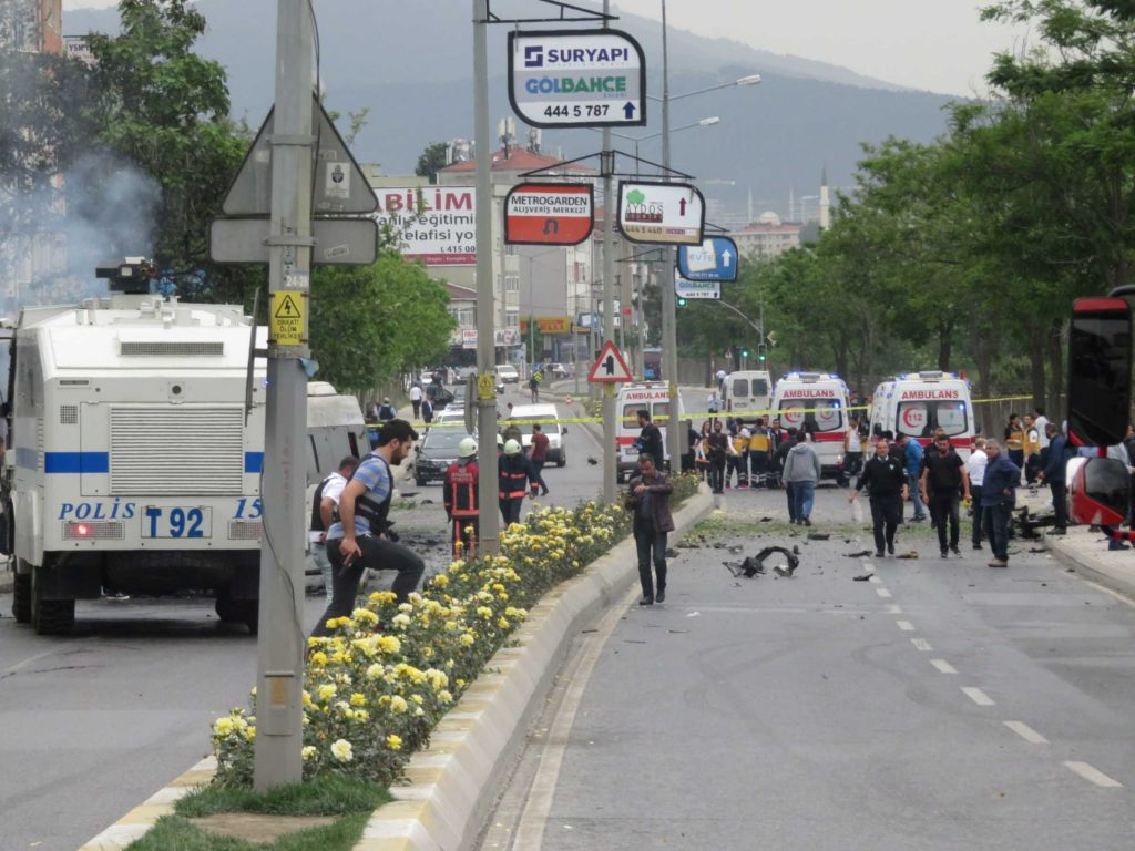 Security officers gather at a scene following a vehicle explosion near a military facility in Istanbul, Turkey, May 12, 2016. Dogan News Agency via REUTERS ATTENTION EDITORS - THIS PICTURE WAS PROVIDED BY A THIRD PARTY. FOR EDITORIAL USE ONLY. NO RESALES. NO ARCHIVE. TURKEY OUT. NO COMMERCIAL OR EDITORIAL SALES IN TURKEY.