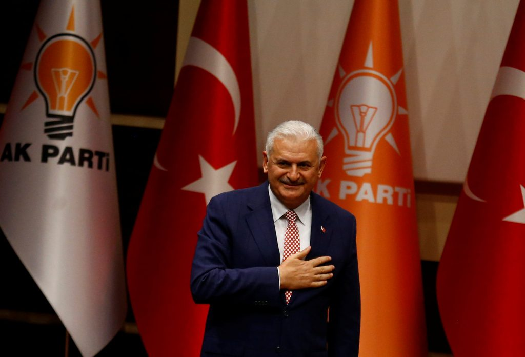 Turkey's likely next prime minister and incoming leader of the ruling AK Party Binali Yildirim greets party members during a meeting in Ankara, Turkey, March 19, 2016. REUTERS/Umit Bektas