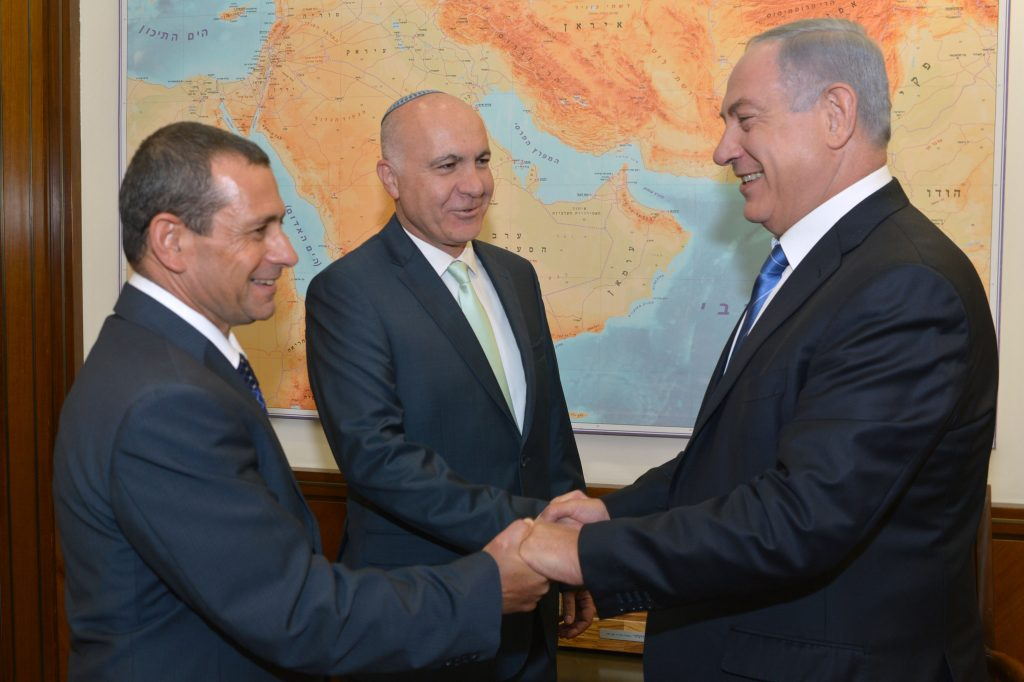 Israeli Prime Minister Benjamin Netanyahu with outgoing head of Shin Bet service Yoram Cohen and incoming head Nadav Argaman, at PM Netanyahu's office in Jerusalem on May 08, 2016. (Kobi Gideon/GPO)