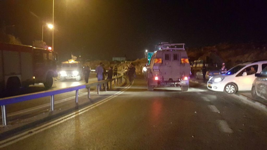 Security and emergency officials at a security checkpoint at the scene of the attack Tuesday night. (Yehudah and Shomron Service)