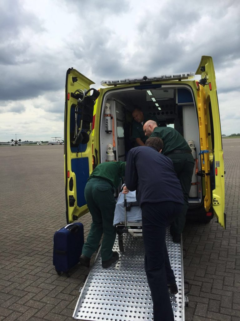 An ambulance awaits the arrival of the medical jet carrying Yehuda Roittenbarg and Binyamin Cohen, on the tarmac in London.