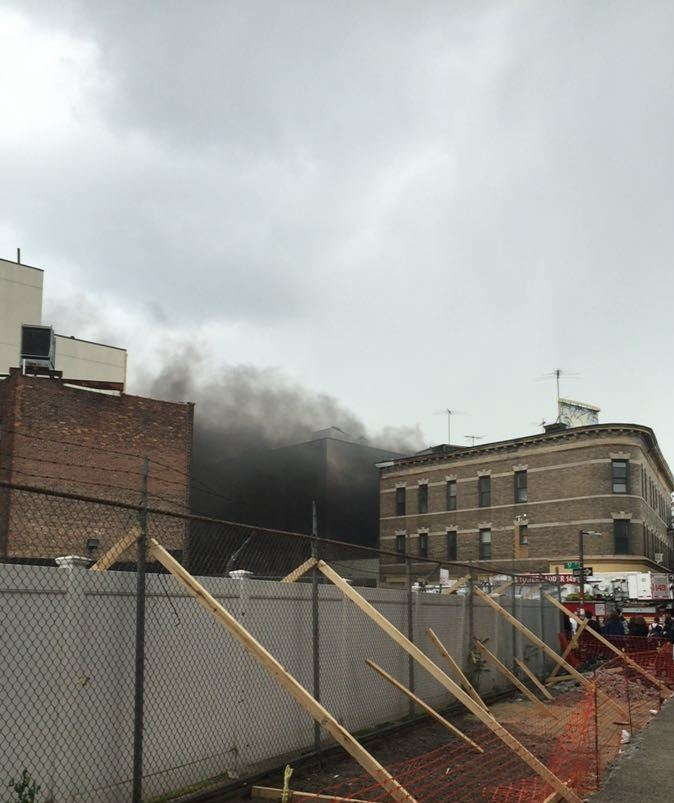 A fire burning Sunday afternoon at 57th Street and 13th Avenue (Ruchie Friedman)