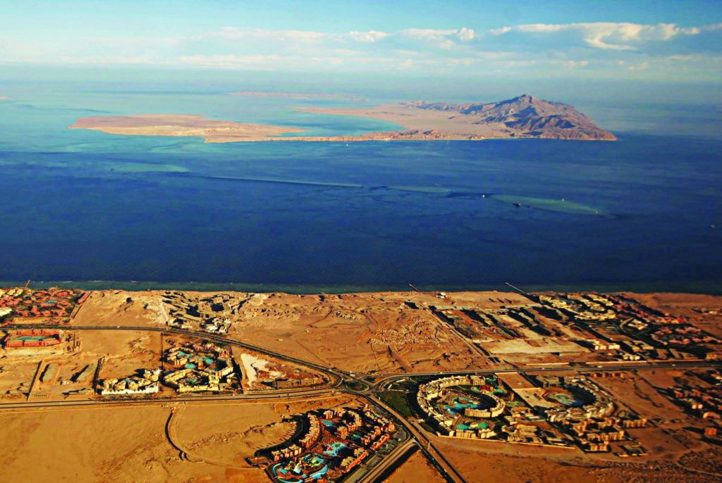 (FILE) A picture taken on January 14, 2014 through the window of an airplane shows the Red Sea's Tiran (foreground) and the Sanafir (background) islands in the Strait of Tiran between Egypt's Sinai Peninsula and Saudi Arabia. Saudi King Salman on April 11, 2016 wrapped up a landmark five-day visit to Egypt marked by lavish praise and multi-billion-dollar investment deals, in a clear sign of support for President Abdel Fattah al-Sisi's regime. Egypt also agreed during the visit to demarcate its maritime borders with Saudi by officially placing the two islands in the Straits of Tiran in Saudi territory. / AFP / STRINGER (Photo credit should read STRINGER/AFP/Getty Images)