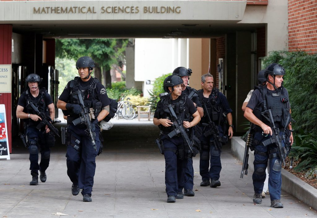 Police officers conduct a search at the University of California, Los Angeles (UCLA) campus after it was placed on lockdown. (Reuters/Patrick T. Fallon)