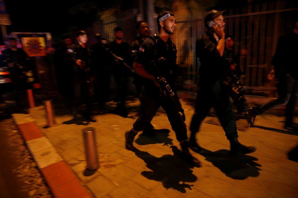 Israel security personnel search the area of the terror attack in Tel Aviv on Wednesday. (Reuters/Baz Ratner)