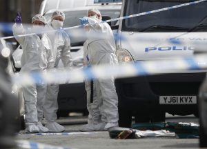 Forensics police officers stand near the scene of the attack in Birstall. (Reuters/Phil Noble)