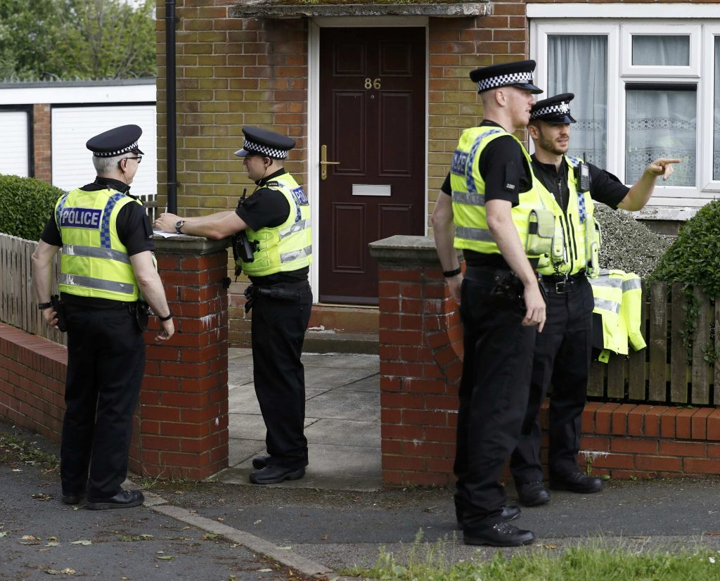 Police officers stand outside the home of the man who was arrested after Labour MP Jo Cox was attacked. She later died of her wounds. (Reuters/Phil Noble)