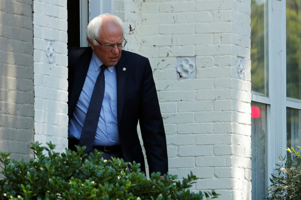 Democratic U.S. presidential candidate Bernie Sanders departs his house to walk to his campaign headquarters on Capitol Hill on Monday. (Reuters/Jonathan Ernst)
