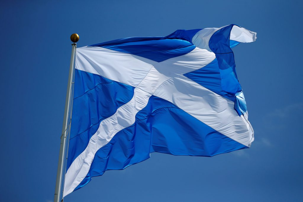 The Scottish flag flies over the Trump International Golf Links in Aberdeen, Scotland, June 25, 2016.  (Carlo Allegri/Reuters)