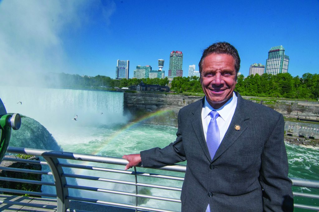 New York Gov. Andrew Cuomo visits the Niagara Falls area Thursday, to tour construction work at Niagara Falls State Park and to announce the name change of the Robert Moses Parkway to the Niagara Scenic Parkway. (James Neiss/The Niagara Gazette via AP)