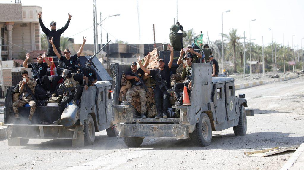Iraqi forces in Fallujah on Sunday. (Reuters/Thaier Al-Sudani)