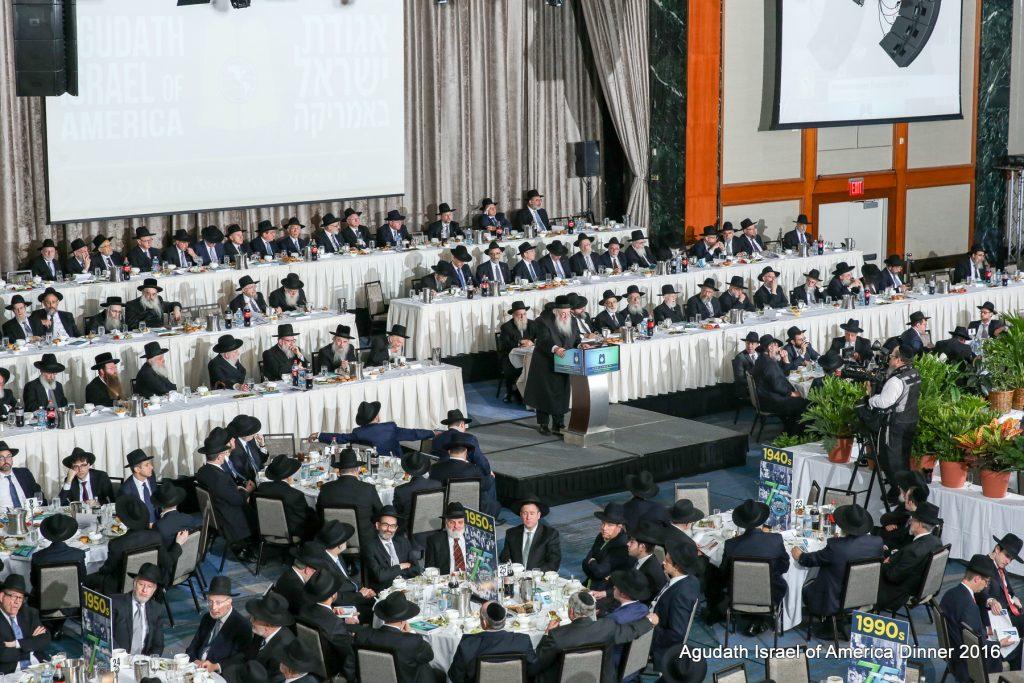 The Novominsker Rebbe, shlita, Rosh Agudas Yisroel, addressing the crowd at the 94th anniversary dinner of Agudath israel of America. (Photos by Menachem Adelman and Moshe Gershbaum)