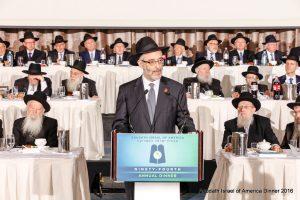 Rabbi Chaim Dovid Zwiebel speaking.