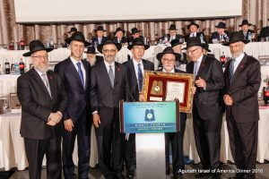 Reb Meir Frischman (third from right), who has served as director of Agudah camps for 40 years, accepted the Rabbi Moshe Sherer Memorial award on behalf of Camp Agudah.