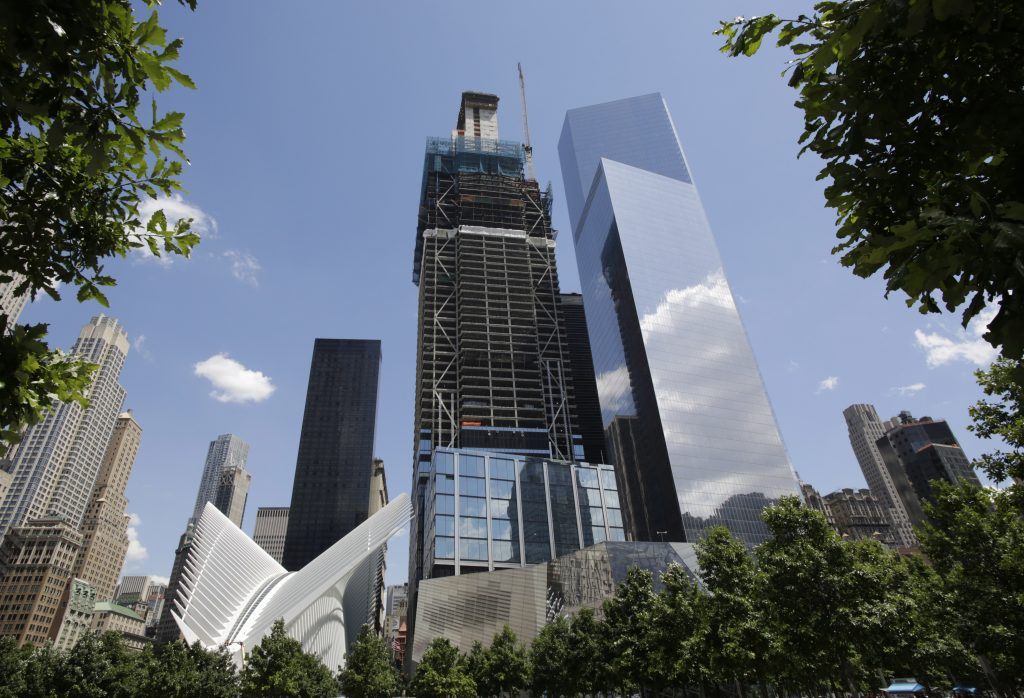 3 World Trade Center, center, has reached its full height of 80 stories in New York. (AP Photo/Mark Lennihan)