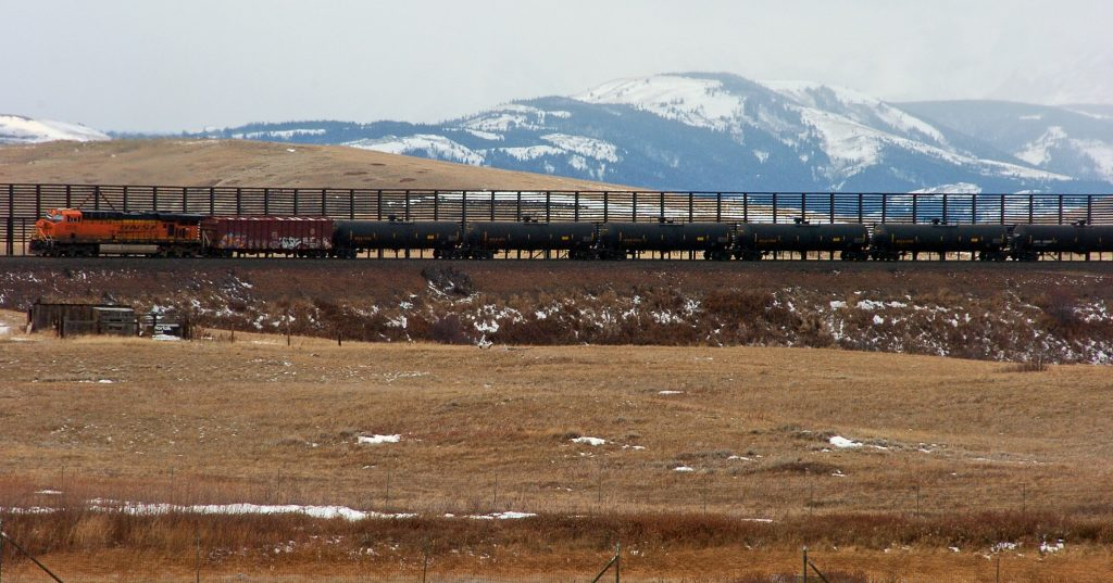 FILE--In this Nov. 7, 2013 file photo, a train hauls oil into Glacier National Park near the Badger-Two Medicine National Forest in northwest Montana. (AP Photo/Matthew Brown, File)