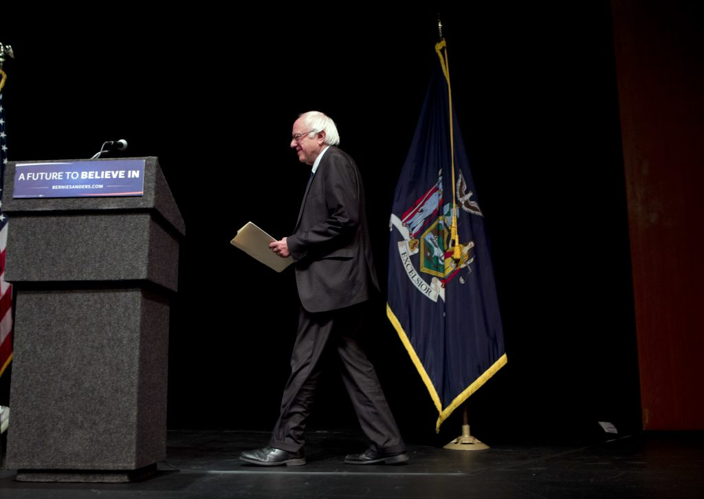 """Democratic presidential candidate Sen. Bernie Sanders, I-Vt., arrives to deliver his """"Where We Go From Here"""" speech, Friday, June 24, 2016, in Albany, N.Y. (AP Photo/Mike Groll)"""