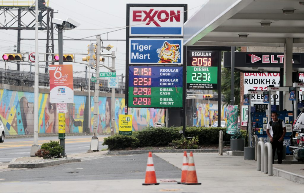 Gas prices are seen at gas stations in downtown Newark, N.J., Tuesday, June 28, 2016. (AP Photo/Julio Cortez)