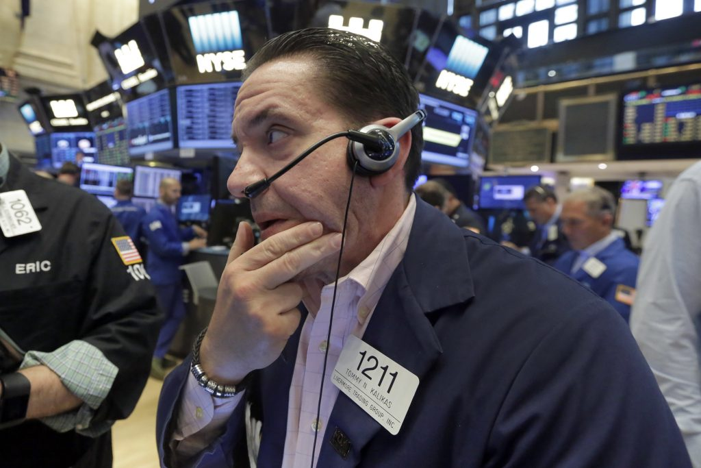 Trader Tommy Kalikas works on the floor of the New York Stock Exchange on Friday. (AP Photo/Richard Drew)